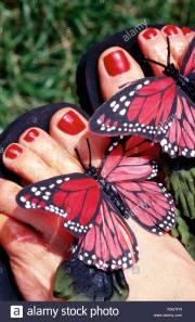 woman feet grass sandals stock
