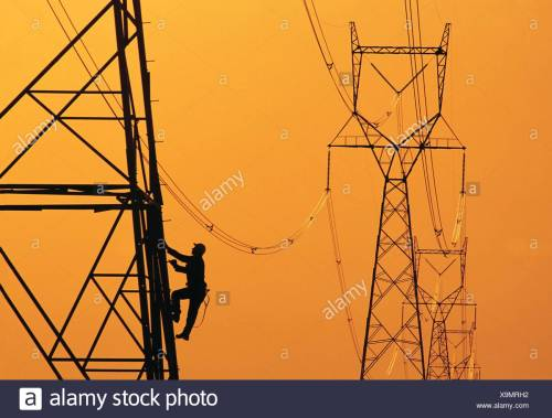 small resolution of a worker climbs an electrical tower manitoba canada stock image