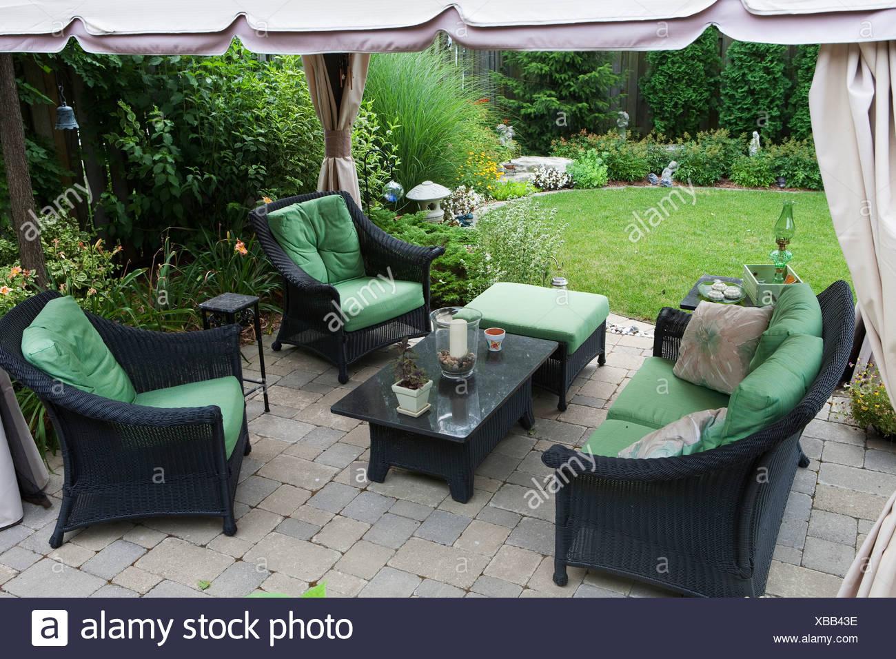 https www alamy com covered patio furniture on stone patio in a backyard burlington ontario canada image282371810 html