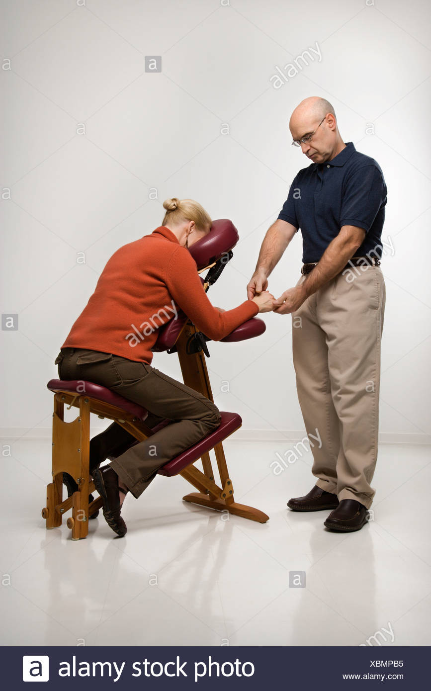 Massage Therapist Chair Caucasian Middle Aged Male Massage Therapist Massaging Hands Of