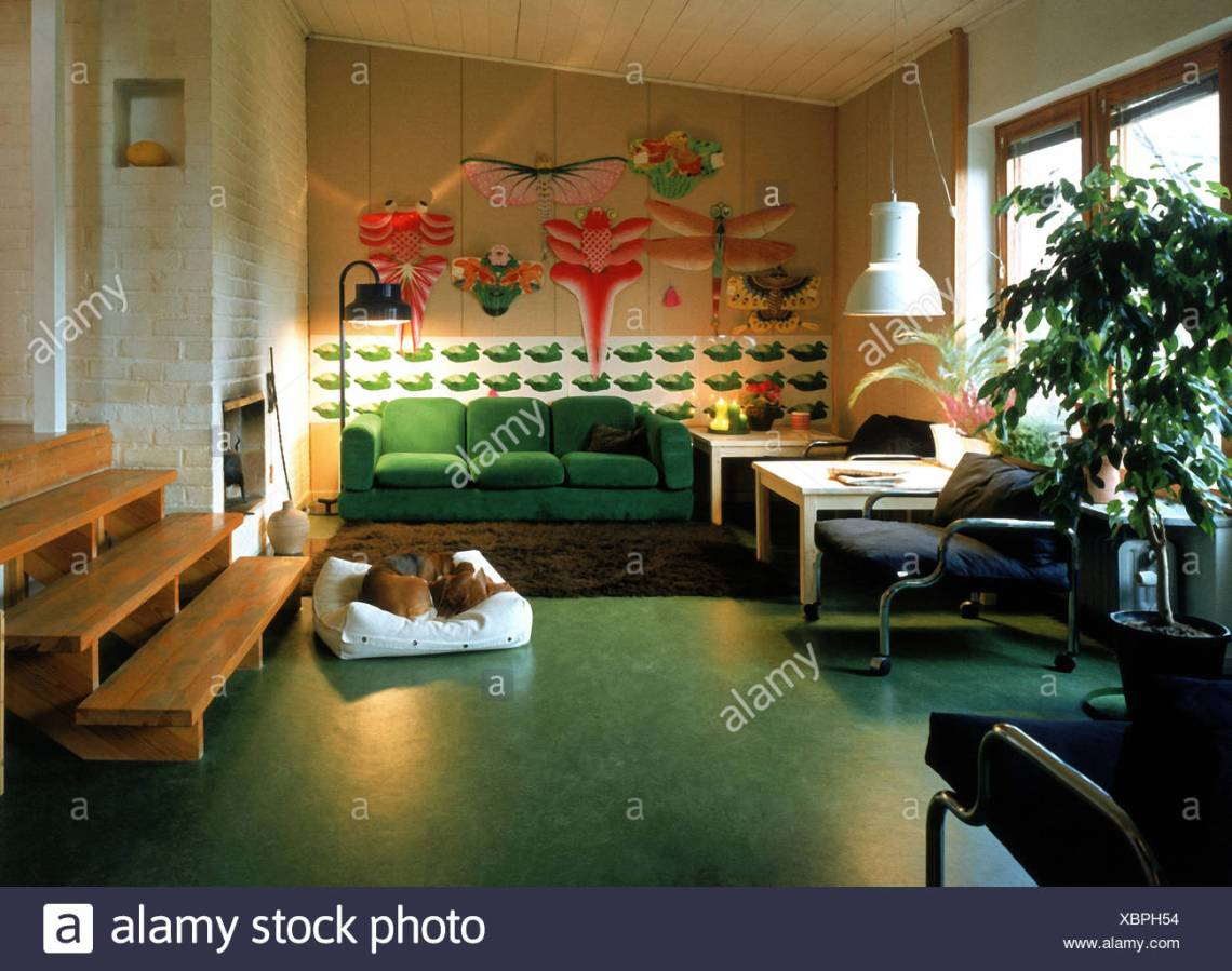 L Homes Living Room Polished Green Flowith Brown Rug And Large White Cushionsdogs Beige Walls Strip Of Green Bird Motifs And Stock Photo Alamy