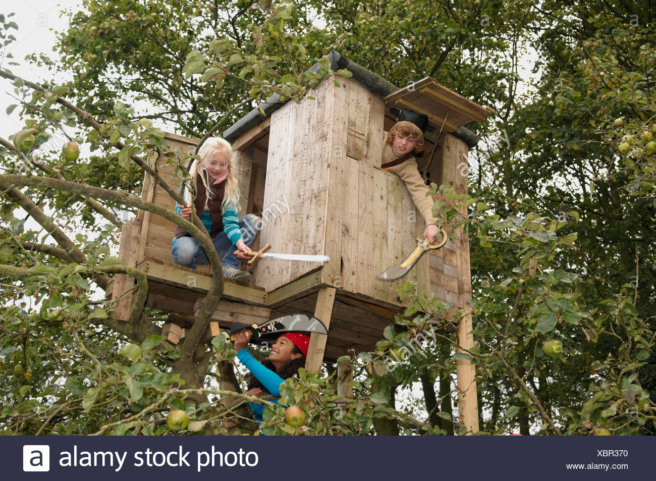 Children Playing In Treehouse Stock Photo Alamy