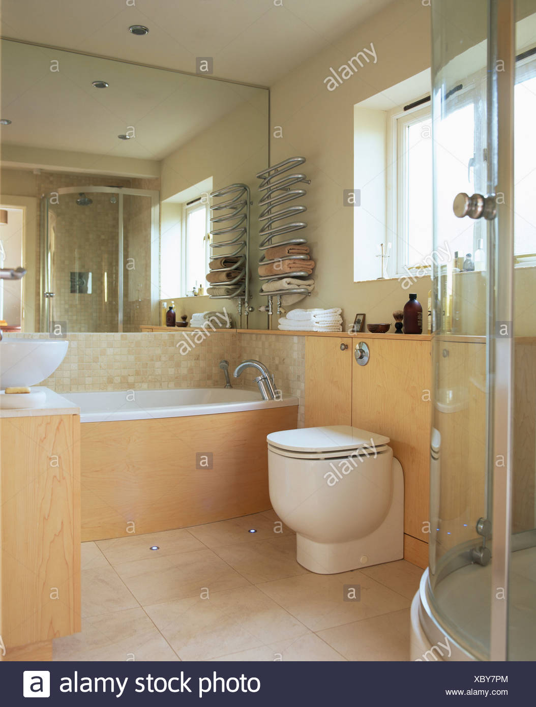 Paneling For Bathroom Mirrored Wall Above Bath In Modern Bathroom With Pale Wood
