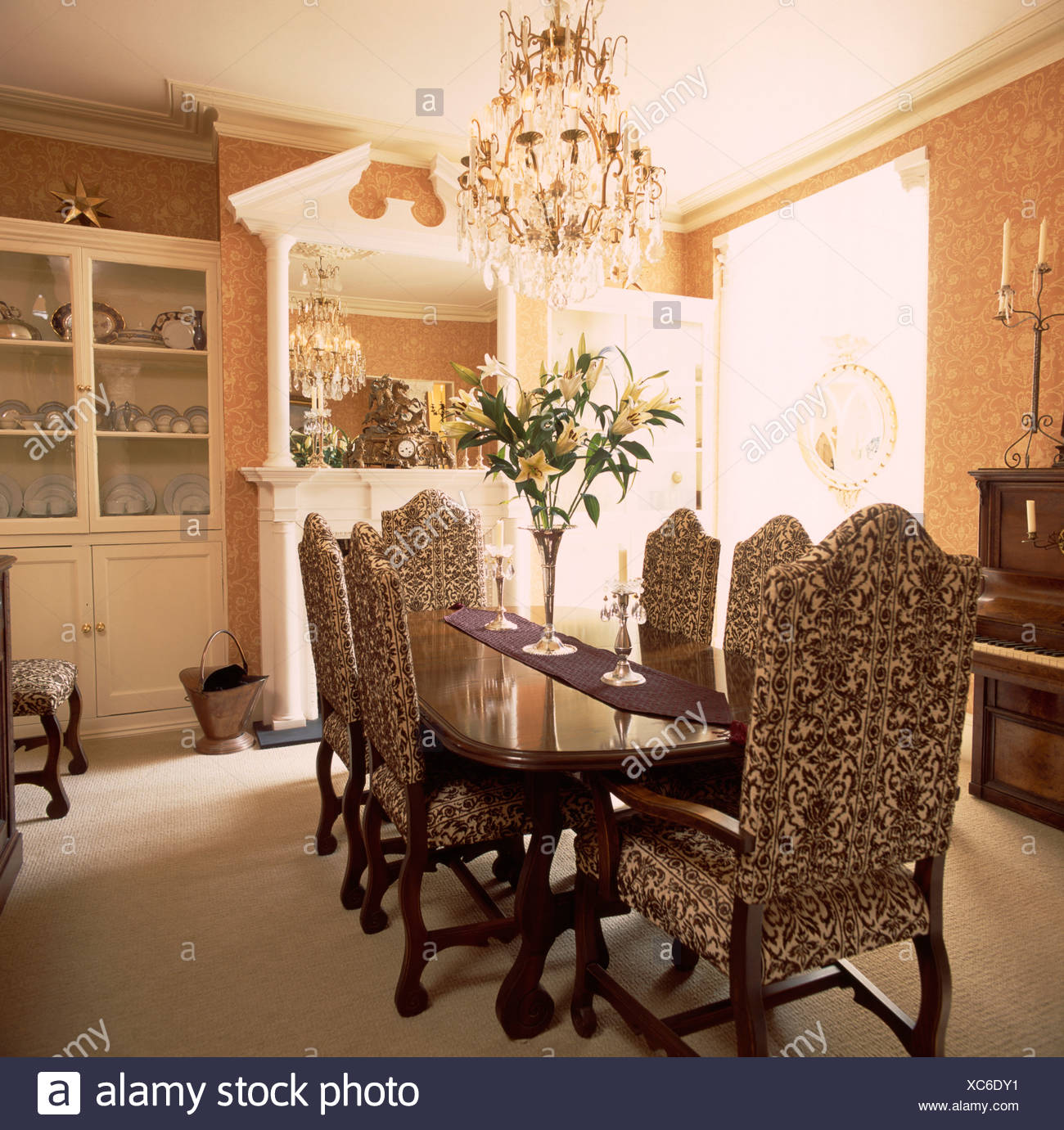Damask Dining Chair Chandelier Above Tapestry Upholstered Chairs And Mahogany Table In