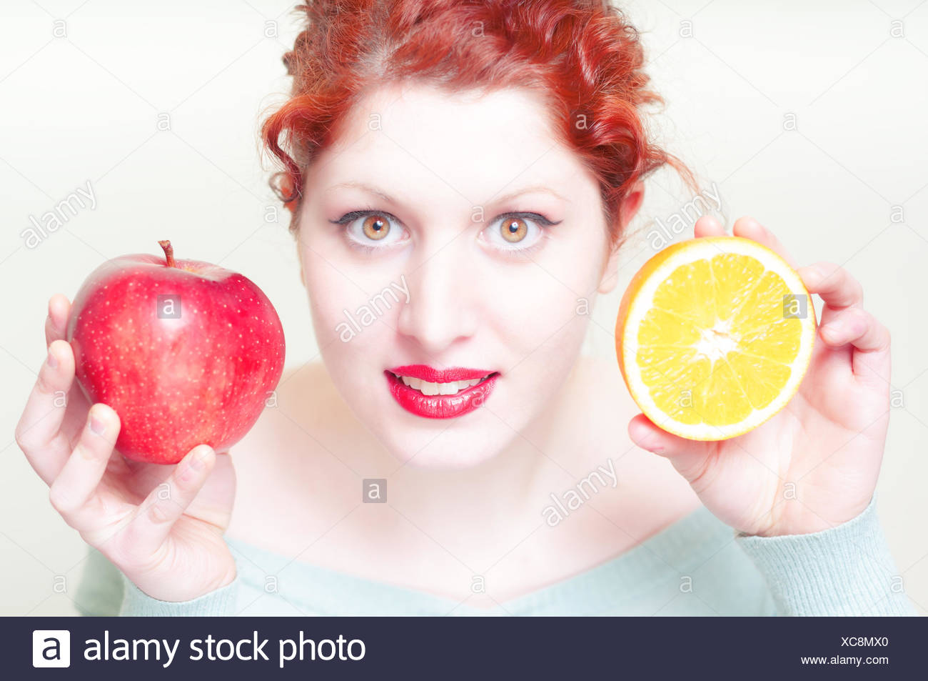 Beautiful Red Hair And Lips Girl With Orange And Apple Stock Photo