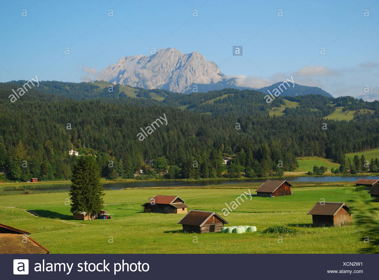 Mostly cloudy, with a low around 59. Germany Upper Bavaria Mittenwald Narrow Lake Wetterstein Range Summer South Germany Bavaria Werdenfels Mountain Landscape Mountains Weather Stone Lake Mountain Lake Meadows Wooden Hut Jahresezeit Stock Photo Alamy
