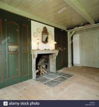 Slate tiles set into wooden floor in front of fireplace ...