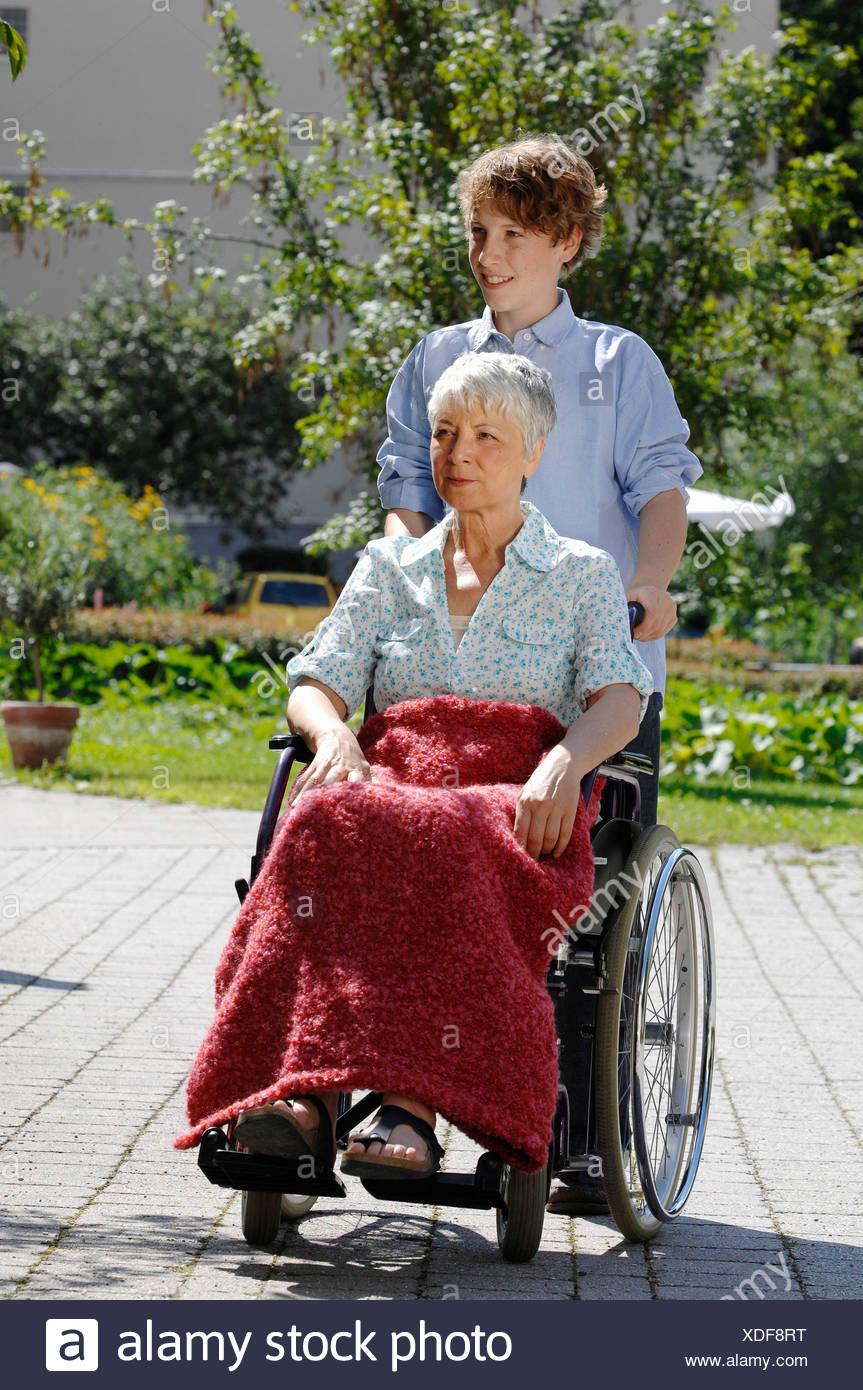 lift chair edmonton alberta potty reviews woman wheel wheelchair disability disabilities stock photos & ...