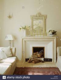 White Mirror Above White Fireplace Stock Photos & White
