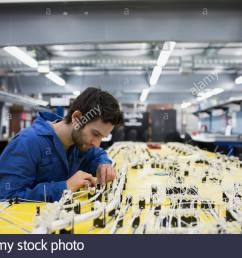 wiring harness stock photos wiring harness stock images alamy factory wiring harness replacement helicopter technician [ 1300 x 956 Pixel ]