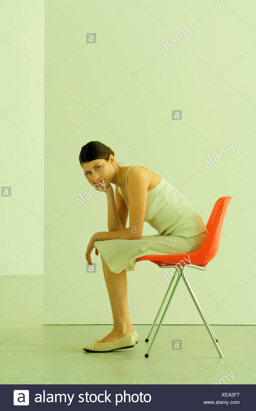 desk chair leans forward tables and chairs melbourne woman sitting in leaning on elbow looking at camera stock