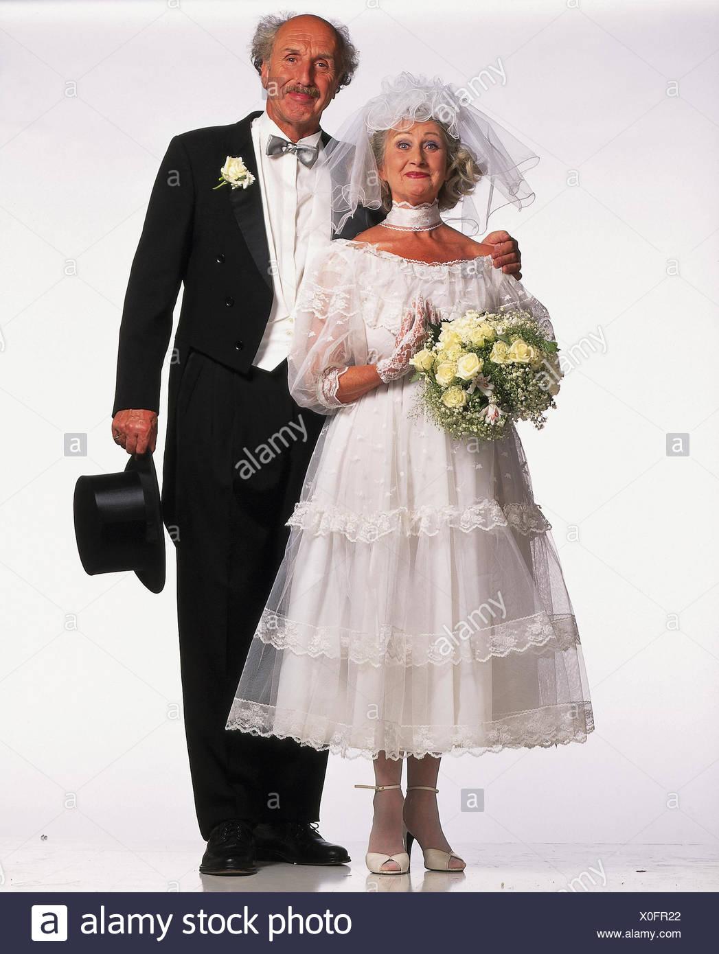Braut und Brutigam Senioren Stnder Hochzeit Kleid wei Braut Strau Frack Zylinder