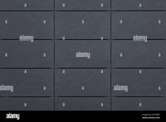 Vista frontal del azulejo en la pared gris oscuro con línea de cuadrícula para la textura Fotografía de stock Alamy