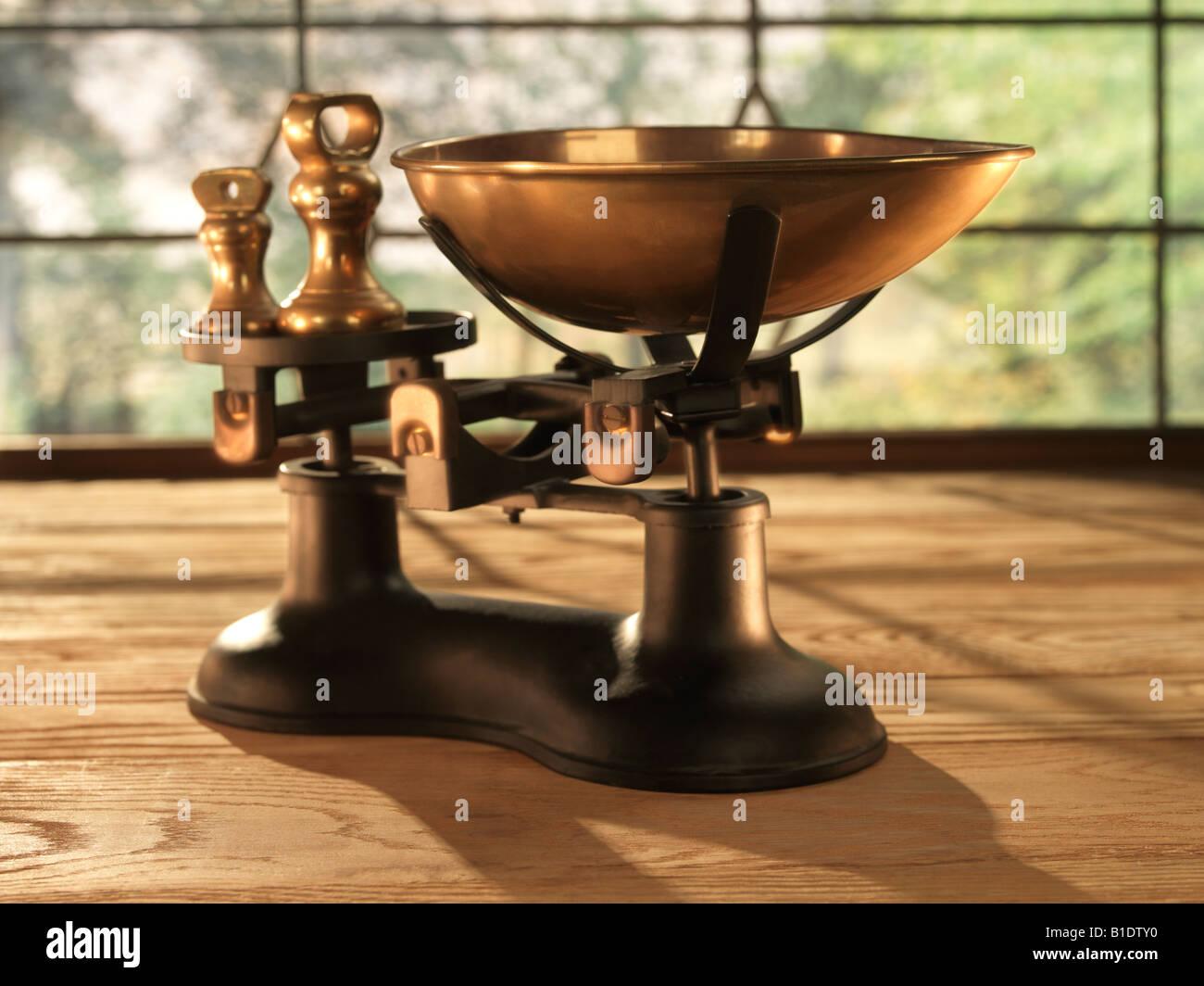 brass scales weighing balanced