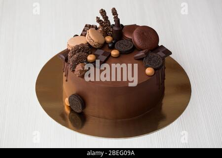 Here is a top gear themed chocolate cake. Chocolate Cake For Men With Chocolate Decorations And The Streaks Of Chocolate Stock Photo Alamy