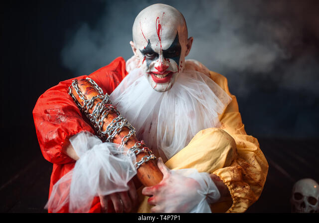 Fortunately, we have all the best scary costumes for babies, children and adults right here! Scary Bloody Clown With Baseball Bat Sitting On The Floor Around The Scattered Parts Of The Human Body Man With Makeup In Carnival Costume Crazy Ma Stock Photo Alamy