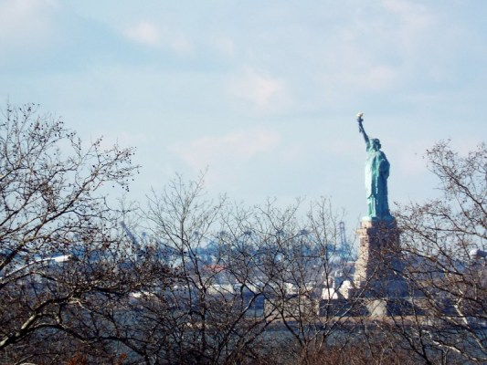 Statue of Liberty seen from Brooklyn Bridge, New York - the tea break project solo female travel blog