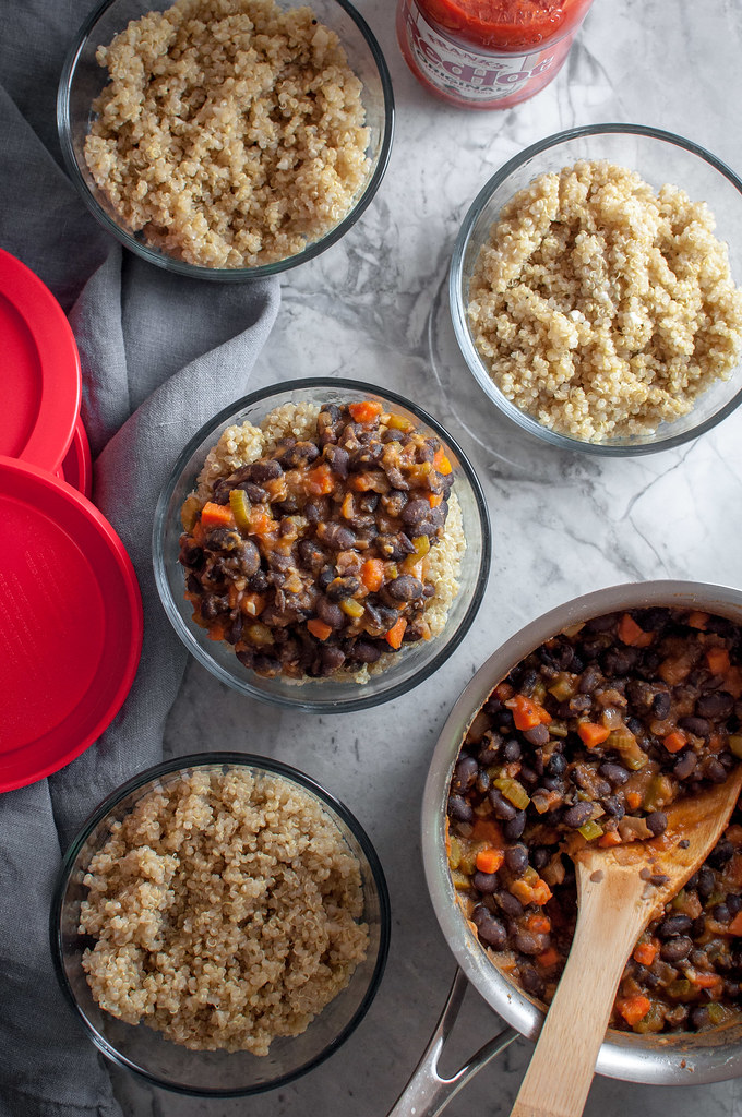Buffalo bowls gone meatless, without sacrificing an ounce of flavor! Quinoa and bean buffalo bowls to make ahead for lunch or dinner meal prep.