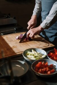 Person chopping vegetables on a cutting board