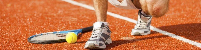 tennis player kneeling