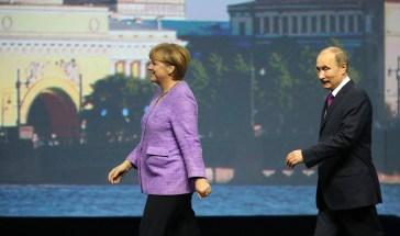 Angela Merkel and Vladimir Putin attend the St. Petersburg International Economic Forum