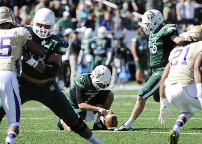 Blake Brewer kicking a field goal against Georgia State - Charlotte Sports Information photo