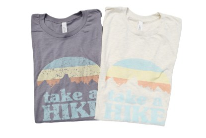 "grey and tan t-shirts that read ""Take a Hike"""