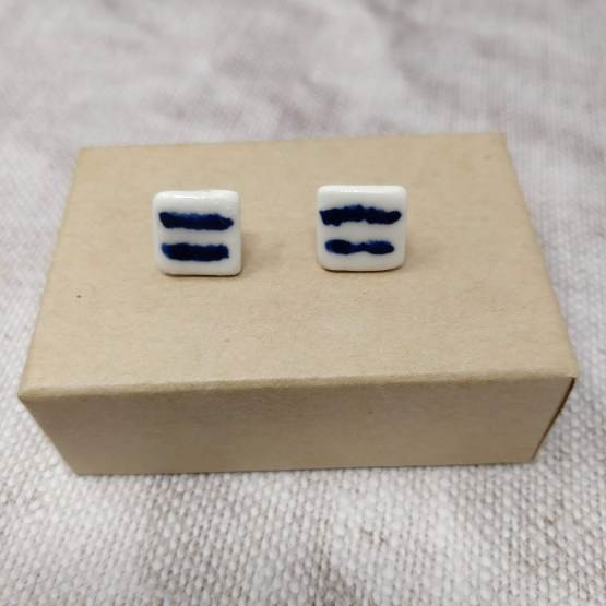 Ceramic earrings with blue lines design