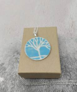 Blue ceramic pendant with white tree design