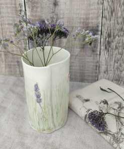 handmade ceramic vase with flower decoration