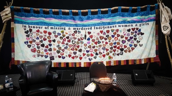 A beaded hearts tapestry produced by the NWT Native Women's Association hangs in the chamber being used for inquiry hearings at a Yellowknife Hotel - Jesse Wheeler-Cabin Radio