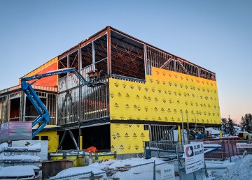 A new gymnasium space, stage, and industrial kitchen is pictured under construction adjacent to Yellowknife's Ecole Allain St-Cyr in January 2018