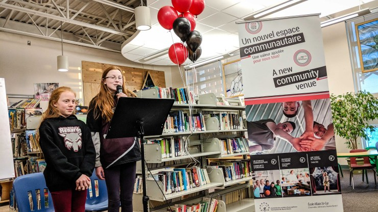 Sema Jalil Aga, left, and Andrea Geraghty, both 12, host a presentation on new buildings at Yellowknife's Ecole Allain St-Cyr, where they are students