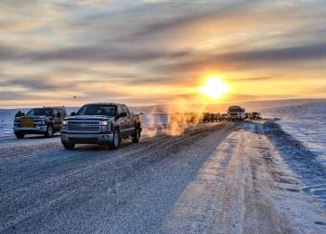 Vehicles on the Inuvik to Tuktoyaktuk all-season road
