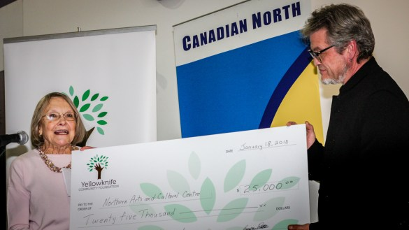Yellowknife Community Foundation president Bronwyn Watters presents a cheque to NACC president Jean-Francois Pitre on January 18, 2018 - Donna Caponi Young