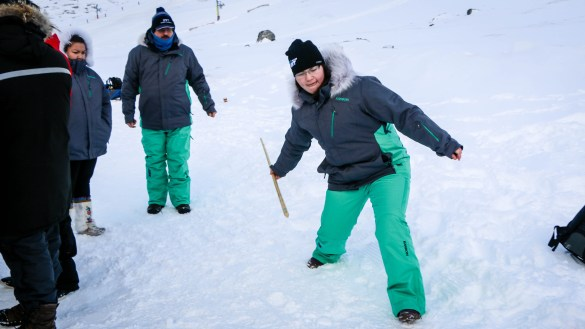 An NWT competitor in snow snake, an event at the Arctic Winter Games