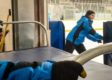 Volunteers at the 2018 Arctic Winter Games speed skating venue