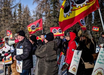 Todd Parsons, president of the Union of Northern Workers (left), stands with union members outside the territorial legislature on March 9, 2018