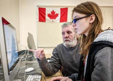 Victoria Sloane and her grandfather, Mike Doyle, share time together with a computer at a Cyber Seniors class. Ollie Williams-Cabin Radio