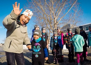 Members of the Fort Smith 'spirit squad' help to cheer during an Arctic Winter Games ceremony in the town