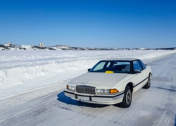 A Buick abandoned on the Dettah Ice Road awaits the return of its owner in April 2018