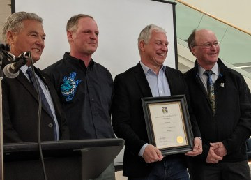 Ed Lippert, second from right, is pictured receiving a YK1 long service award in 2018