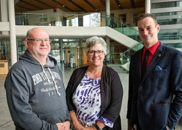 NWT MLAs Shane Thompson, Julie Green, and Kieron Testart in the Great Hall of the Legislative Assembly in Yellowknife