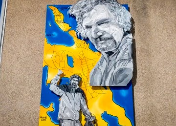 Terry Pamplin's mural of Charlie Delorme hangs from a 48th Street building in Yellowknife
