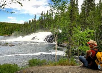A tourist at the NWT's Cameron Falls. Hans Pfaff-NWT Tourism