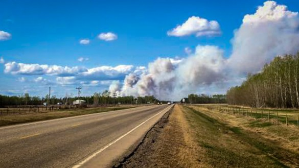 An image posted online by Jane Groenewegen shows a forest fire burning north of High Level in May 2018