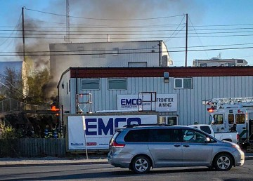 Smoke and flames are seen to the side of the EMCO building in Yellowknife - Colton Rieger-Steed-Twitter