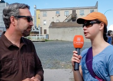 Cabin Radio's Alice Twa, right, interviews Yellowknife's Mayor Mark Heyck about a pop-up park proposal