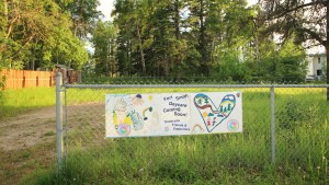 A file photo shows a banner at a proposed Fort Smith daycare site in June 2018. A community daycare finally opened in the town's Community Recreation Centre in September 2020. Sarah Pruys/Cabin Radio.