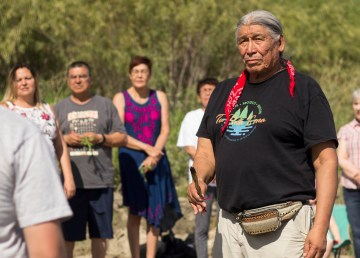François Paulette, a Denesuline Elder and member of the Smith's Landing Treaty 8 First Nation, leads a Celebrate the Water ceremony in June 2018. Sarah Pruys/Cabin Radio